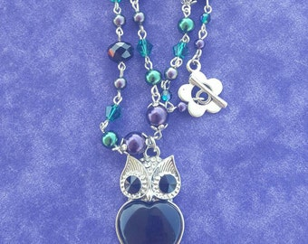 Handmade beaded owl necklace.