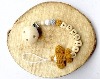 personalized pacifier cord with wooden beads and crocheted airplane