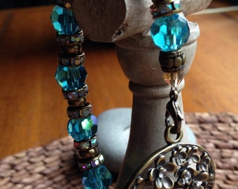 Turquoise and antique brass beaded bracelet