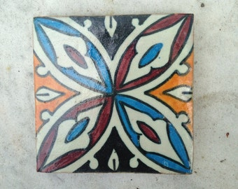 Vintage hand painted tribal tile from Morocco.