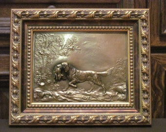Hunting dog with a hare. Pictures of copper.