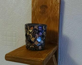 Wall mounted candleholder