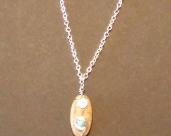 rock pendent with silver wire accents