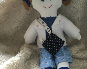 Rag doll in light blue and white outfit