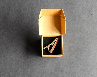 Wooden tie clip.