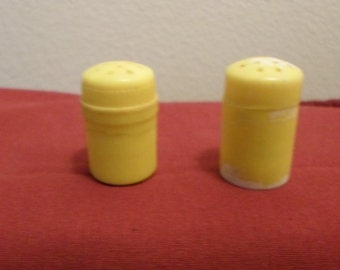 Tiny yellow plastic salt and pepper shakers