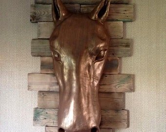 Horse Sculpture on wood.