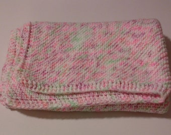 Hand-knit baby girl blanket