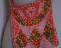 Vintage 70's / hippie beaded orange bag