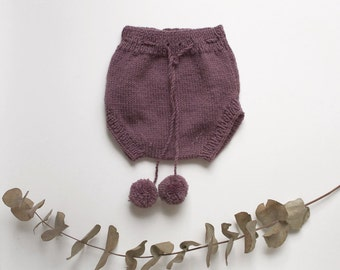 Pompon purple baby bib