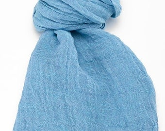 Blue linen scarf with fringes. Soft and fashionable shawls will add a fresh touch to your look and liven up any ordinary.
