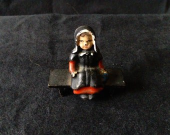 Vintage Cast Iron Amish Girl on Bench