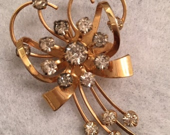 Bouquet brooch in gold