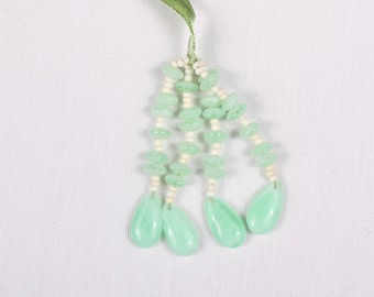 8 PomPoms of pearls 40x110mm, polyester, mint (9097)