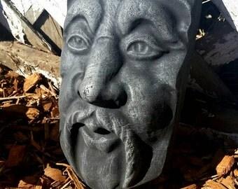 Outdoor Garden statue. Garden face.