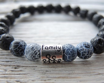 Men lava bracelet with jeans agate beads and silver family bead.