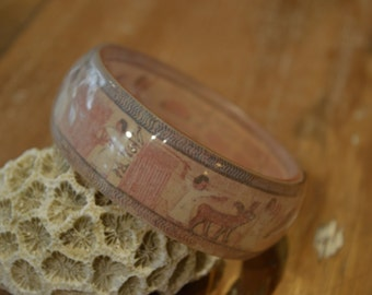 Resin red and beige grounds Egyptian bracelet