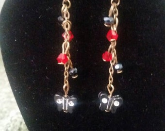 Handmade bronze dangle earrings with red crystals and black butterflys