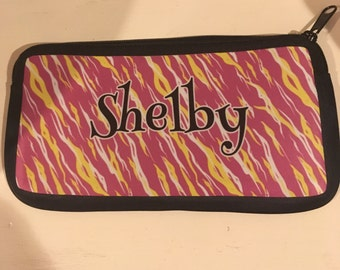 Pencil, cosmetic, or device bag zebra print with name