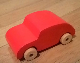 Handmade red wooden old beetle car
