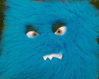 Fluffy electroblue monster pillow