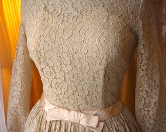 Tea length beige, ecru, or taupe cotton lace 50's dress with nipped in waist and full circle skirt, size 8 .