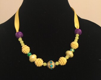 Yellow with a touch of purple. Made for a princess.
