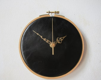 unusual wall clock in black leather