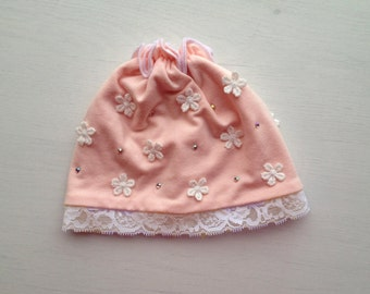 baby girl hat with lace trim, lace flowers and rhinestones