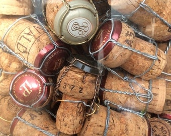 Giant corks set , big set of 50  Champagne corks and capsules , with wirehoods giant lots of corks and capsules and muselet