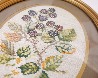 A hand worked petit point/ cross stitch/ embroidered blackberry, oval framed picture : beautifully stitched.