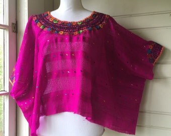 Beautiful huipil poncho style top.