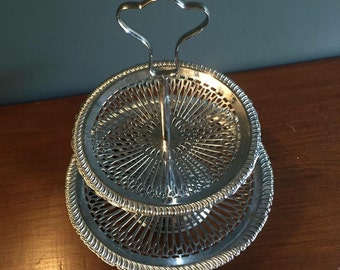 Decorative two tiered cake stand with spoke detail.