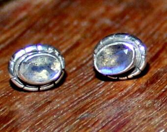 Natural Rainbow moonstone stud earrings in sterling silver.