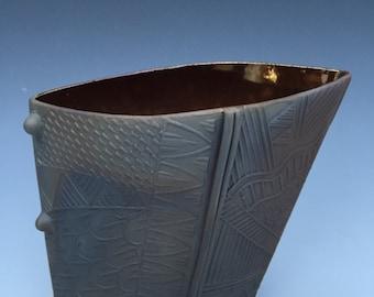 Smoke fired terracotta vessel