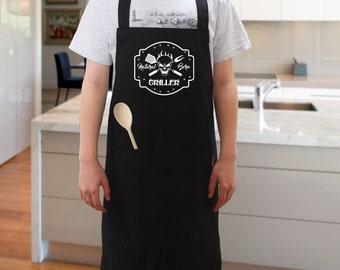 Natural Born Griller  BBQ Apron, Novelty Apron, Cooking Apron, For Dads, Fathers day. Black Apron with Pocket for Barbecue Cooking