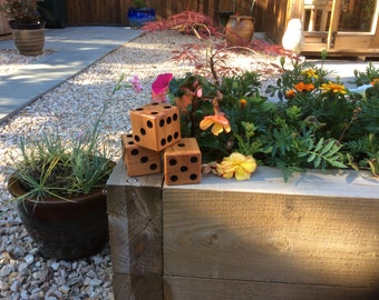Hand made outdoor play dice.