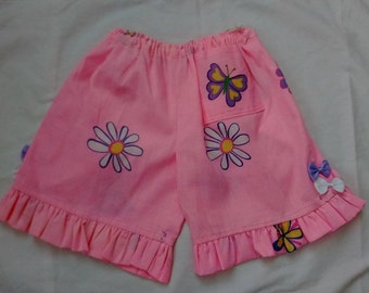 girls pink shorts with with a frill