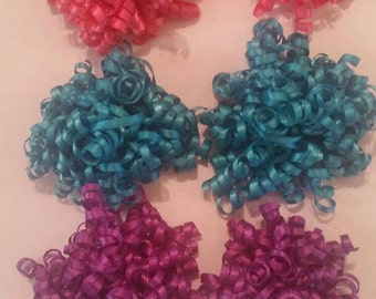 Lot of 3 sets of satin korker bows in pink, blue, and purple.