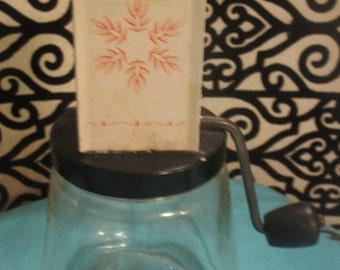 Vintage Androck nut grinder with pink snowflake