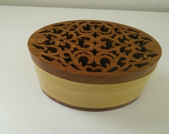 Oval box with fret work hand cut top