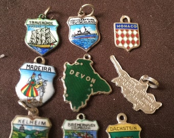 Vintage silver travel enamel shields