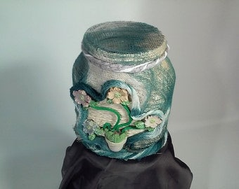 Home furnishings-jar decorated with flowers in rope and wood