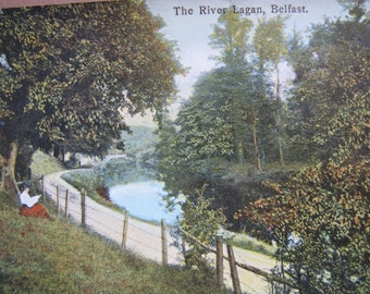 The River Lagan Belfast postcard / unposted / Eyre & Spottiswoode publisher / woman sitting by river postcard