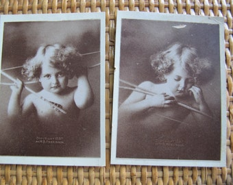 Cupid awake cupid asleep antique photos / Taber Prang Art Ltd Photographs