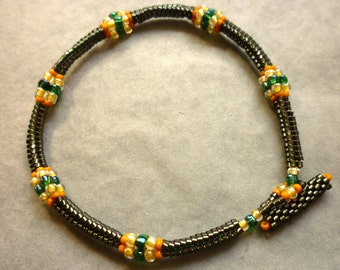 Gunmetal green delicas beaded bracelet with yellow accents