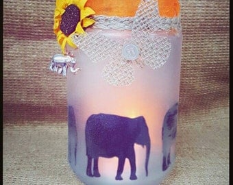 Elephant silhouette candle holder with charm, butterfly and flowers.