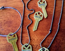 Give a Key  Necklace or Bracelet stamped w/ DREAM, LOVED, Marry Me, Friend, Forgiven,ETC. Use Your Own Personal Word. Cut or Uncut Keys