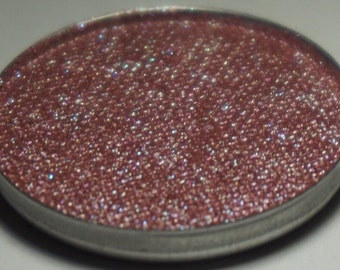 Carina Duochrome Pressed Eyeshadow - Midtoned Warm Mauve Base with a Strong Turquoise Blue Duochrome and Turquoise Reflects