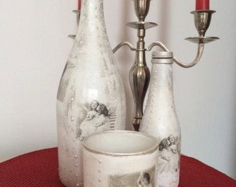 Bottles and candle glass with angels
